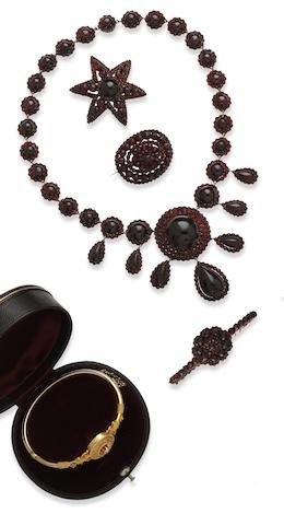 A collection of 19th century and later garnet jewellery and a diamond set bangle (5)