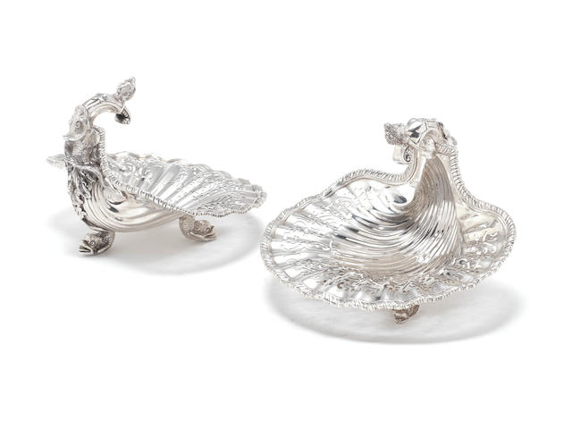 A Victorian pair of silver dessert baskets after Paul De Lamerie, by Samuel Hayne & Dudley Cater, London 1868