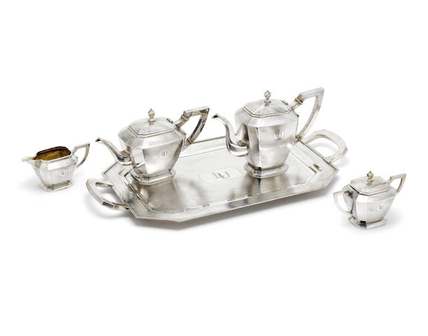 An early 20th century five-piece Chinese export silver tea and coffee service including tray by Nanking Jewlry Co, Nanking, circa 1920