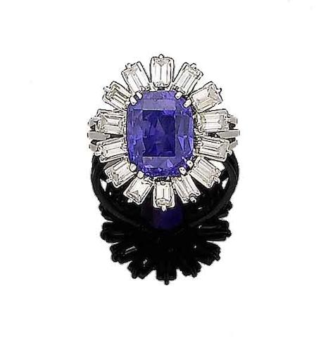 A colour-change sapphire and diamond cluster ring