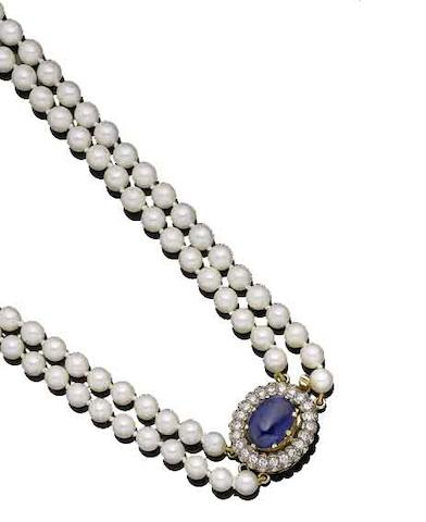 A double-strand cultured pearl necklace with a sapphire and diamond clasp,