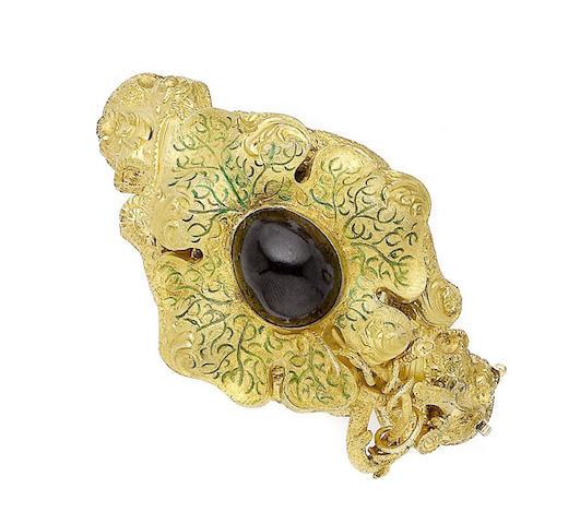 A mid 19th century gold, enamel and garnet hinged bangle