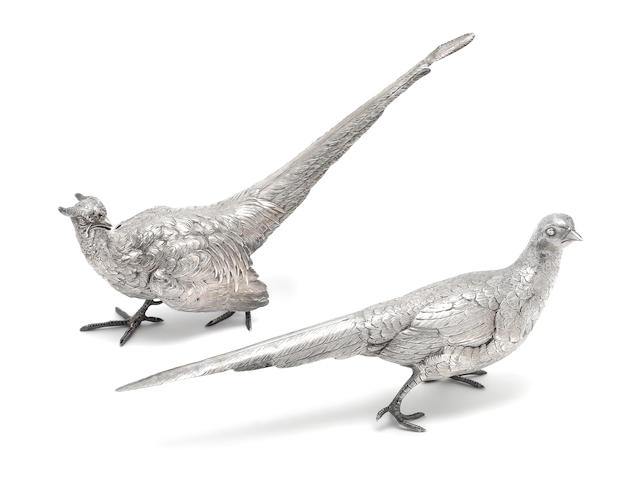 A matched pair of silver pheasant table ornaments the male, by Neresheimer & Sohne, Hanau, with import marks for Berthold Muller, London 1924, the female, with import marks for Adolph Barsach Davis, London 1928   (2)