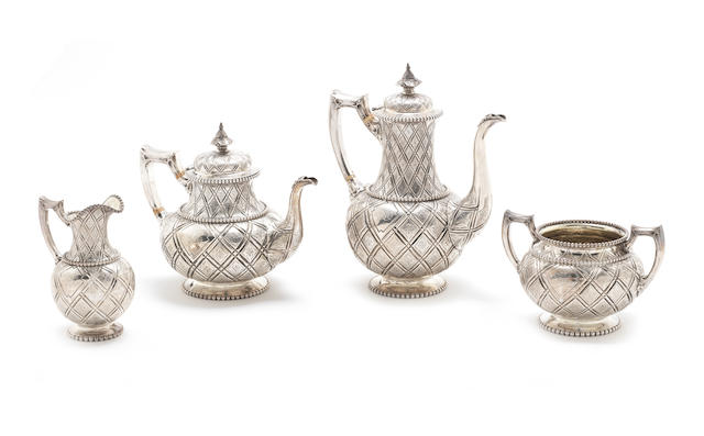 A cased Victorian silver 'Abercrombie' pattern four-piece tea and coffee service by Robert Hennell, London 1863 together with a pair of Victorian silver salts, by Horace Woodward & Co, Birmingham 1893 (6)