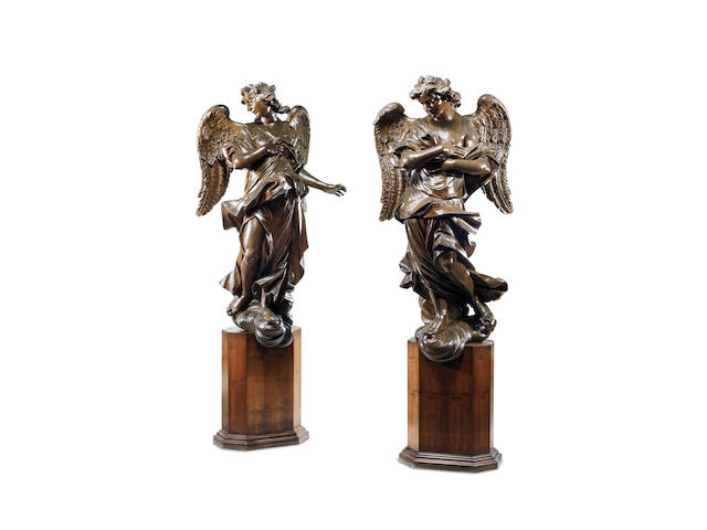 An impressive pair of large North Italian or South German late 17th or early 18th century carved, gilded and painted figures of angels
