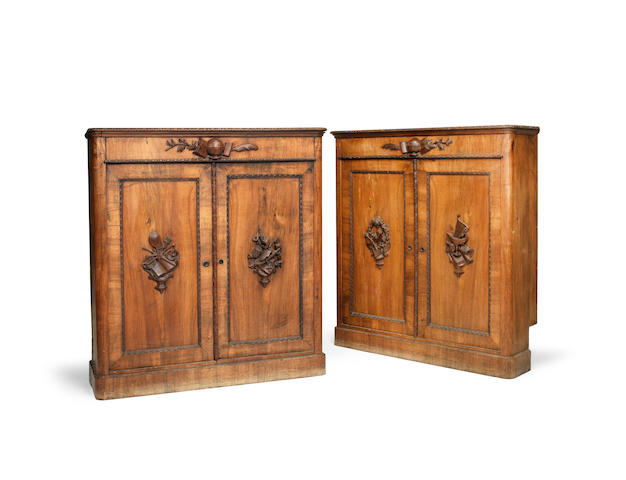 A pair of central European mid 19th century walnut side cabinets