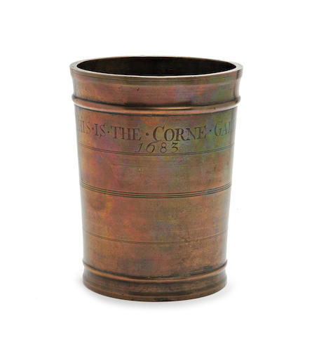 A rare and unusual copper alloy gallon measure, dated 1683