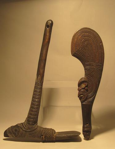 A Maori stone adze and handclub, 47cm and 44cm long respectively (2)