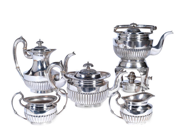 An early 20th century five-piece Chinese export silver tea and coffee service, including kettle on stand by Nanking Jewlelry Co, circa 1920 (5)