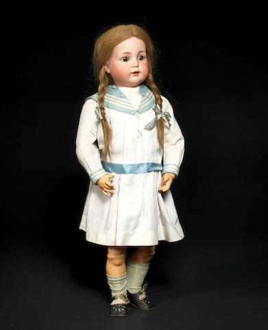 A rare Kämmer & Reinhardt open mouth 117A bisque head character doll