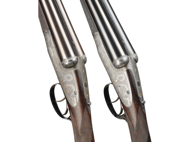 A matched pair of 12-bore round-bodied sidelock ejector guns by Boss & Co., no. 5085/8186 In a Boss brass-mounted oak and leather case