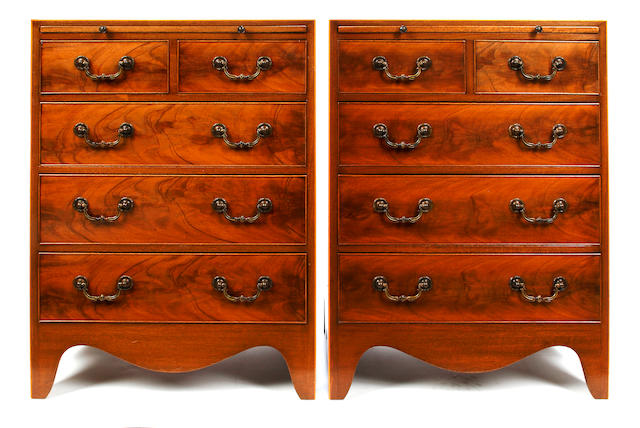 A pair of George III style mahogany small chests