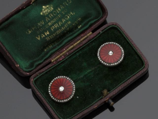 A pair of enamel and diamond dress studs