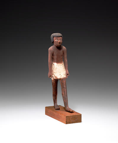 An Egyptian polychrome wood standing figure