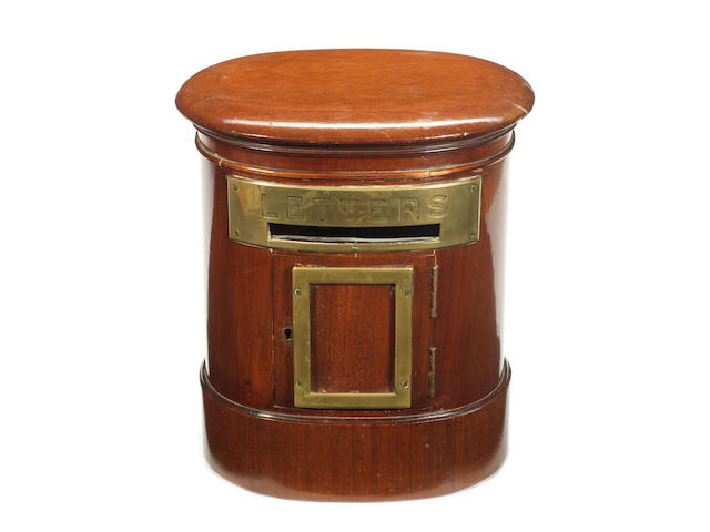 A late Victorian mahogany and brass bound oval country house post box