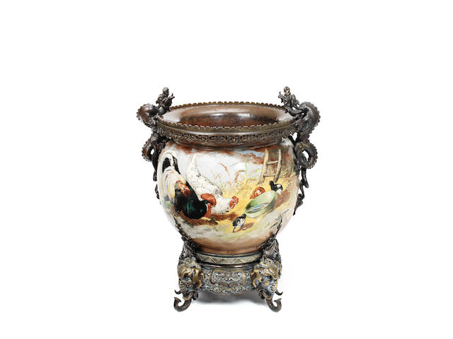 A late 19th century French bronze mounted faience jardiniere  the mounts in the Japonisme taste, the jardinere body signed A. Lebarque
