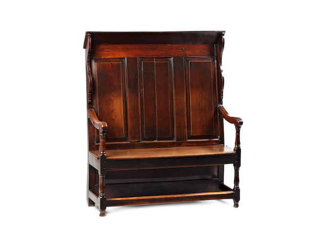 A rare and good small mid-18th century oak canopy-settle, English, circa 1740