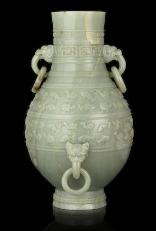 A magnificent Imperial pale green jade archaistic vase, hu Qianlong four-character fang gu mark and of the period