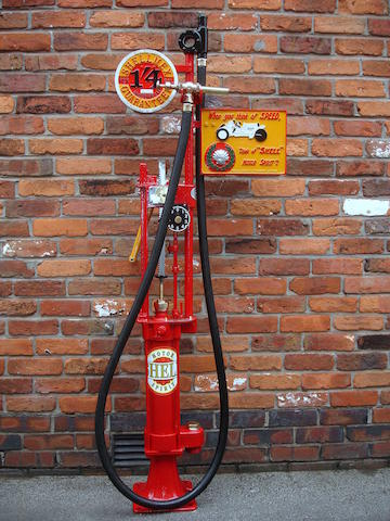 An early English-made Bowser skeleton hand-operated petrol pump,