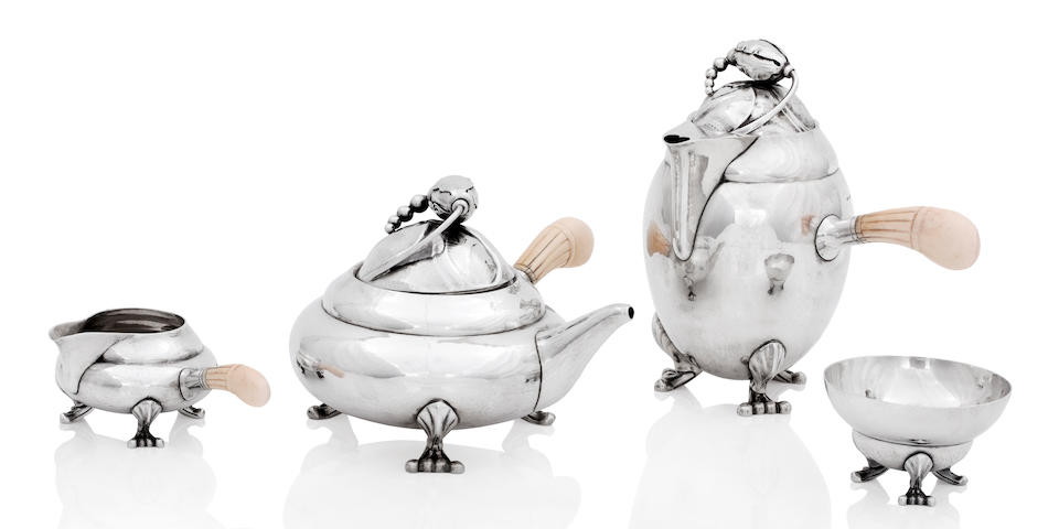 Georg Jensen; A Blossom pattern four piece silver tea service The teapot, cream jug and sugar bowl 1925-1932, the hot water pot 1933-1944, each numbered