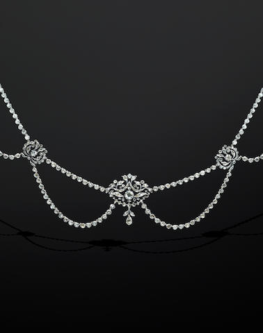 A diamond set swag necklace, two pairs of diamond set earpendants and a diamond pendant (4)