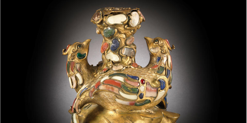 A rare imperial gilt-bronze and hardstone and glass embellished 'double phoenix' vessel and liner Qianlong (2)