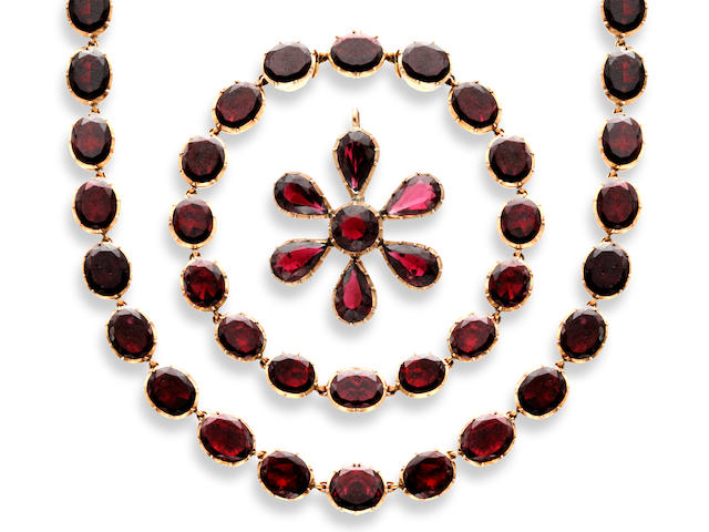A 19th century garnet necklace, bracelets and pendant suite