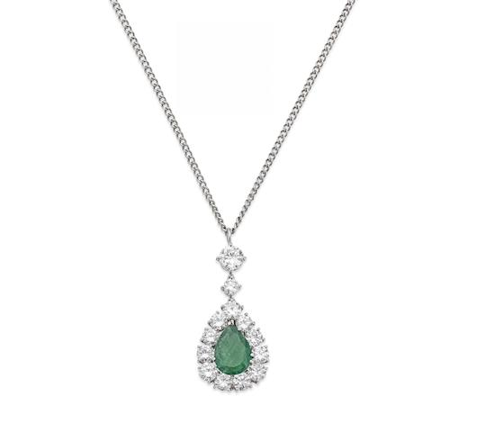 An emerald and diamond cluster pendant