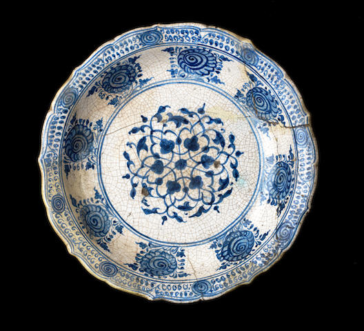 A large Timurid underglaze painted blue and white pottery Dish Persia, 15th Century