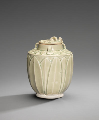A rare small Yueyao 'lotus-bud' jar and cover Five Dynasties