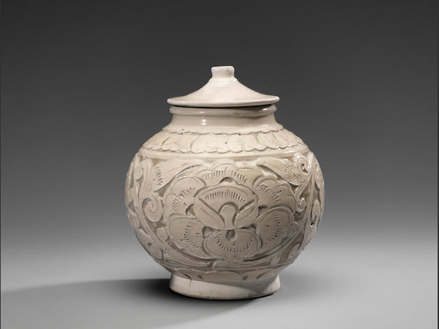 A very rare Cizhou 'peony-scroll' carved globular jar and cover Northern Song Dynasty