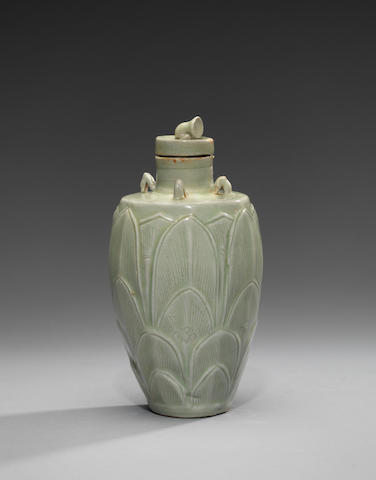 A rare small Yueyao 'lotus-bud' carved slender baluster jar and cover Five Dynasties