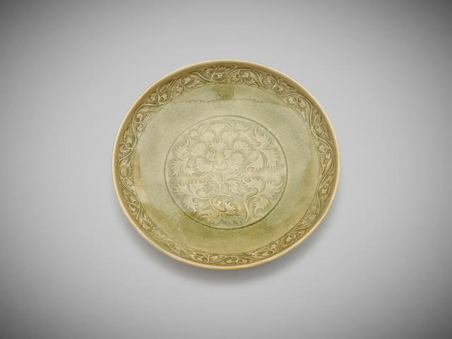 A carved celadon-glaze 'scrolling foliage' yaozhou dish Northern Song dynasty