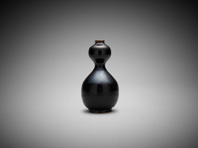 A Chinese black-glaze double gourd vase Yuan or Ming dynasty