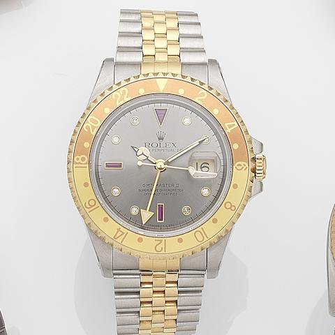 Rolex. A stainless steel and gold automatic calendar bracelet watch with diamond and ruby set dial GMT-Master II, Ref:16713, Serial No.W20****, Movement No.684****, Circa 1994