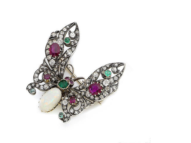 A ruby, emerald, opal and diamond butterfly brooch