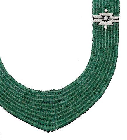 A multi-strand emerald necklace with diamond clasp