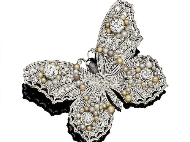 A pearl and diamond butterfly brooch