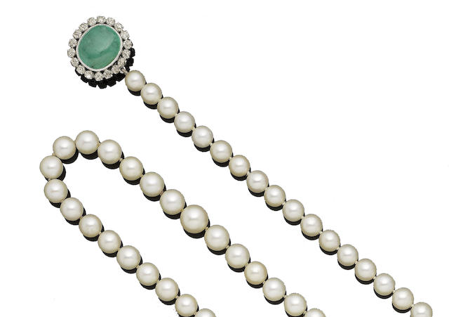 A single-strand cultured pearl necklace with emerald and diamond clasp