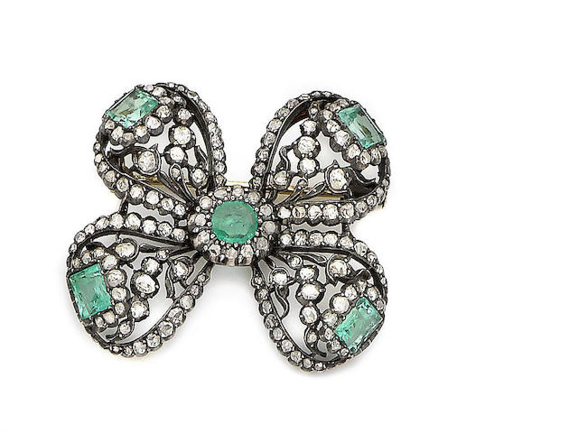 A late 19th / early 20th century emerald and diamond bow brooch/pendant