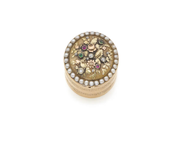 A mid-19th century matched three-colour gold, split-pearl and gem-set pill box the underside stamped '18c' only, circa 1850