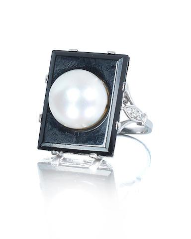 An art deco natural pearl and onyx ring, circa 1930