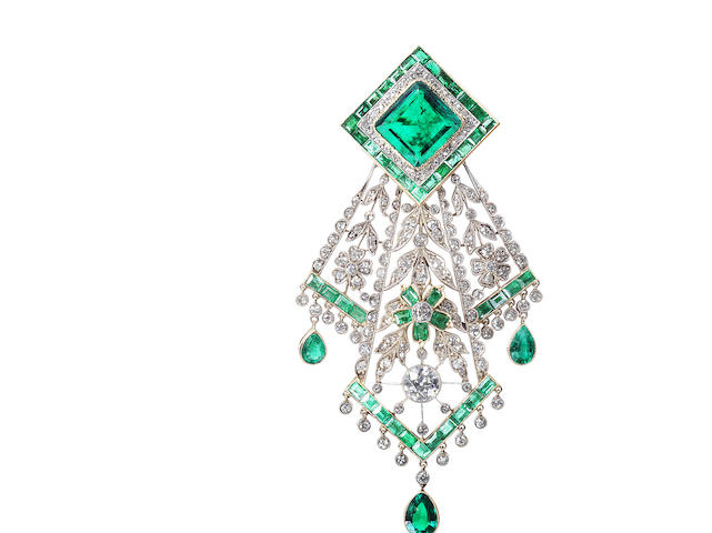 An emerald and diamond handkerchief brooch,