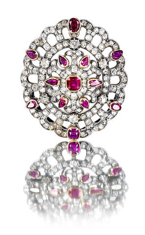 A diamond and ruby brooch/pendant,