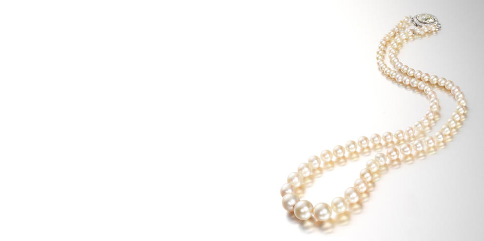 A single-strand natural pearl necklace with diamond clasp,