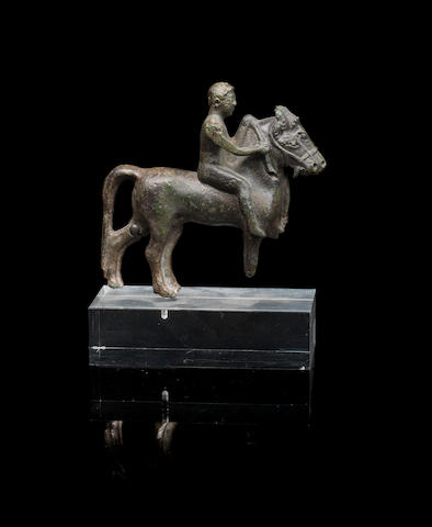 A Greek bronze rider with two horses