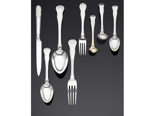 An extensive George III silver Hour Glass pattern table service of flatware and cutlery by William Eley, William Fearn & William Chawner, London 1808, knives by Moses Brent, London 1808 (304)