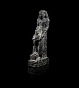 An Egyptian dark green stone Osiriphoros statue for Padiaset