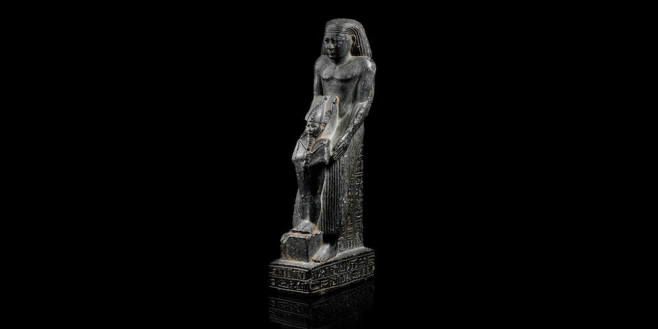 An Egyptian dark green stone Osiriphoros statue for Padiaset