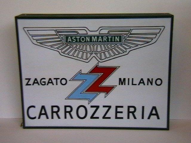 An 'Aston Martin Zagato Milano Carrozzeria' illuminating sign,